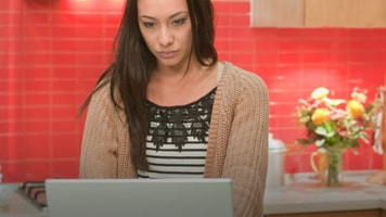 Woman checking her laptop